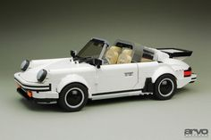 https://flic.kr/p/XL1CMP   911 Targa   Instructions NOW available through www.arvobrothers.com  Back in 2009, we wanted to change radically our way to build vehicles. After several big models like the GT40 or the Suzuki Escudo, we realized that we needed to reduce drastically the scale in order to get a more refined and simple finish. That was our main objective at that time when the idea of the 911 crossed our minds for the first time.