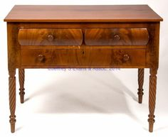 """KENTUCKY CHERRY & MAHOGANY LATE FEDERAL SERVER, the rectangular top over two veneered convex drawers over one flat veneered drawer, both flanked by stiles with burl veneer appliques & raised on spiral-carved ring-turned legs. Circa 1830-1850. 34 1/2"""" H, 20 1/2"""" 43 1/2"""" top. This server descended in the Cowan family of central Kentucky. Captain John Cowan (1748-1819) was an early Kentucky settler who eventually took up residence in Lincoln Co., KY."""