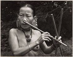 Malaysia   Penan woman playing the nose flute, Borneo The Penan people, one of the last hunter-gatherer tribes living in the Malaysian state of Sarawak, Borneo, c.1950s © Hedda Morrison