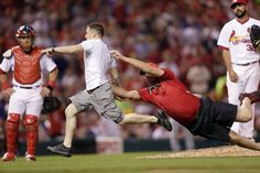 At least this one was wearing clothes.. LOL..St. Louis Cardinals Team Photos - ESPN  A Busch Stadium usher tries to tackle a man running on the field as St. Louis Cardinals relief pitcher Carlos Villanueva, right, and catcher Tony Cruz, left, watch during the sixth inning of a baseball game against the Chicago Cubs, Monday, May 4, 2015, in St. Louis. (AP Photo/Jeff Roberson)