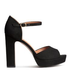 Platform sandals in imitation suede with an ankle strap with metal buckle. Covered heels, imitation leather lining and insoles, and rubber soles. Front platform height 1 in., heel height 5 in. Place to purchase at link