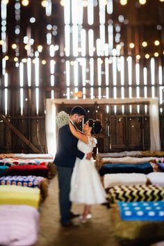 David's Bridal bride Christine selected a short lace wedding dress with cap sleeves and vintage flair for her Boho barn wedding.
