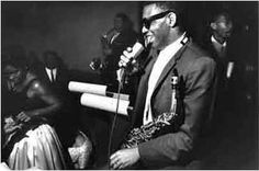 "Ray Charles at a dance hall in '58: standing, holding a microphone, and keeping his sax ready (all rare!). Photo by Paul Hoeffler. The girl prob. is Margie Hendricks. Almost certainly to be associated with this caption: ""roller rink, Rochester, NY, 1958. Saxophonist Hank Crawford is behind Charles and either Pat Patrick or Leroy Cooper [?] is in background"". The rink then was Eddie's Roller Palace in Chestnut Street. The bari player is Leroy. Cf…"
