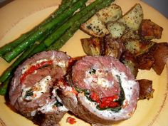 Stuffed Flank Steak with Red Peppers, Sun Dried Tomatoes and Goat Cheese