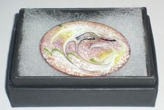 Enamel brooch - scrolled white, yellow, green and black over pale red-brown £7.50