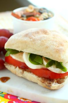 Take advantage of cooler temperatures and colorful scenery, and pack the perfect Summer picnic with a delicious Roasted Garlic Caprese Sandwich! Caprese Sandwich Recipe, Sandwich Recipes, Good Food, Yummy Food, Yummy Eats, Yummy Yummy, Picnic Sandwiches, Entree Recipes, Lunch Recipes