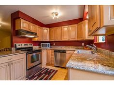 Light maple cabinets with chocolate glaze and santa for Bleached maple kitchen cabinets