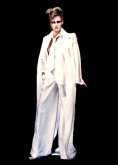 Lloyd Klein wide-leg pants with a floor length trench coat with intricate embroidered epaulets both in off white for spring summer