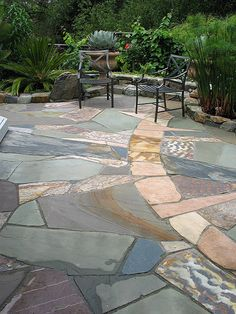 Much better than stamped concrete or traditional flagstone layout