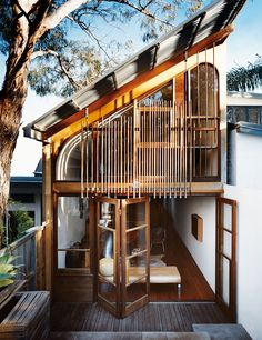 Cool backyard elevation, interesting use of opening & screen walls.  More About Us: http://krigarealestate.com