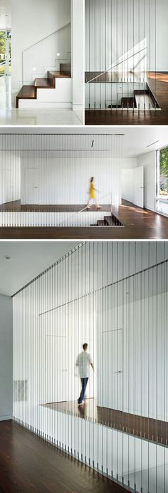 Wood covered stairs lead up to the second floor of this modern house, with vertical cables providing a safety railing for the open stairwell.