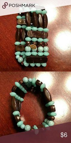 Turquoise and brown bead bracelet Elastic turquoise and brown beaded bracelet. Beautiful piece. Cookie Lee Jewelry Bracelets