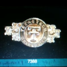 Texas Tech class ring with three diamonds on each side. In silver $1239.46