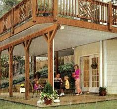 elevated deck with patio underneath, just like ours.. Add decorative ceiling fan and outdoor heaters for patio. Perhaps enclose the deck for more of a greenhouse look. Maybe even expand the kitchen and/or dining room on the upper story.