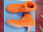 ooh how cool knitted boots, I bet they feel like slippers at the same time as looking super stylish!