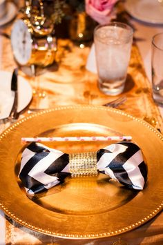 Pink and sassy- Kate Spade inspired wedding at the Hyatt Regency Greenville by B & R Events Chevron napkin with rhinestone napkin ring and polka dot straw