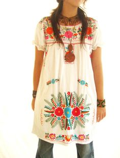 This Mexican dress looks great over jeans...love the woven bracelet too.