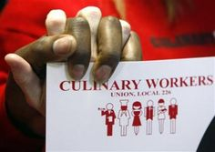 Members of the Culinary Workers Union Local 226 join hands at the announcement of the union's endorsement of Senator Barack Obama (D-IL) for president in Las Vegas, Nevada January 9, 2008. REUTERS-Rick Wilking