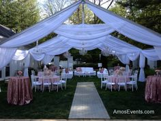 An open air tent draped in white with nine crystal chandeliers.    www.AmosEvents.com