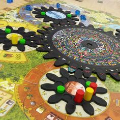 AMAZING custom painted Tzolk'in cogs. #boardgames #customize #tzolkin