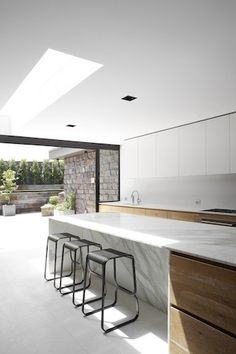 Daylight entering the kitchen inside the Dale House by Robson Rak Architects. For such glowing marble/natural stone surfaces, contact www.TheMarbleMan.com.au FREE Call: 1800 627 626.