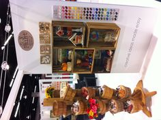 A display of our new soy paint line inside our booth. #PlaidCrafts