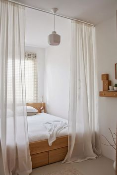 Short on space in the bedroom? Adding shear curtains masks the tight fit with a touch of elegance.