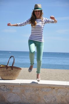 love the mint green pants with stripes and beach bag