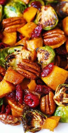 Roasted Butternut Squash and Brussels sprouts with Pecans and Cranberries is one of the best holiday side dishes youll ever try! This side dish is packed with vegetables and nuts. Its healthy gluten-free vegetarian and rich in fiber! Side Dish Recipes, Veggie Recipes, Vegetarian Recipes, Cooking Recipes, Healthy Recipes, Cooked Vegetable Recipes, Vegetarian Christmas Recipes, Vegetable Meals, Squash Vegetable