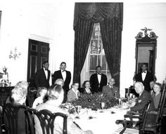 President Harry S. Truman, First Lady Bess Wallace Truman, and members of their family eat Christmas dinner at the White House, December 25, 1947.