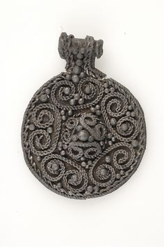 Viking pendant in guilded silver filigree, grave find from Sweden.