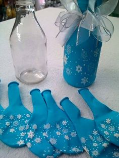 Put a balloon over a glass bottle to make a specialized vase. Very inexpensive and super cute!