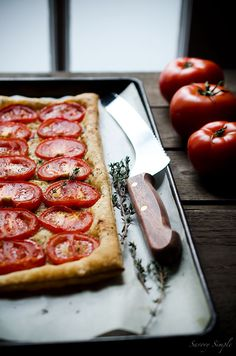 This simple tomato tart is made with only 4 ingredients: tomatoes, puff pastry, roasted garlic and fresh thyme. Get this seasonal, flavorful appetizer recipe from SavorySimple.net Full recipe