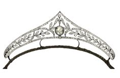Larger image  Natural Pearl and Diamond Tiara, Circa 1900 The openwork tiara of foliage motif, set with old mine-cut diamonds together weighing approximately 9.00 carats, the centre highlighted by a natural pearl measuring approximately 12.96 x 12.44 x 11.99mm, mounted in silver-topped gold, length approximately 190mm, one tiny diamond deficient. - Image Sotheby's