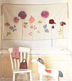 Flower wall hanging - love the idea of something like this for an upcoming shoot, then they can send it with the pics to the grandparents