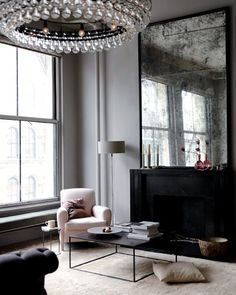 I'm mad about this smoked mirror!  Ochre, and the SOHO apartment of it's owners,  always inspires me.....a perfect mix of elegant pieces coupled with simple modern design & decor.