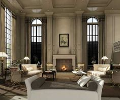 Love those tall floor to ceiling windows, and the simulated columns flanking the fireplace