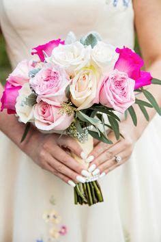 Cute, subtle details such as a jeweled Mickey charm can a touch of magic to any Disney bouquet