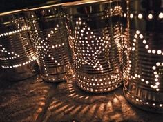 how to make tin can lanterns. Prolly paint them too that way they look pretty during the day.