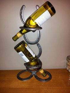 Metal art counter top wine rack. Made of by DeadWoodRising on Etsy