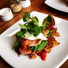Delicious bacon and egg on sweet potato rosti with wilted spinach at Shucked in Newstead.