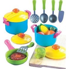 Small World Living Toys Young Chef Cookware Set, reminds me of a set of cast iron miniature cookware my Grandma had that we'd play with whenever we came to visit.