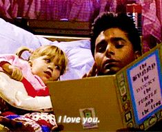 Pin for Later: Have Mercy! 27 Times You Adored Uncle Jesse When he reads her bedtime stories.