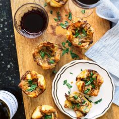 An elegant appetizer that pairs perfectly with Bordeaux wine. Cambozola cheese, caramelized onions and pears in pastry.