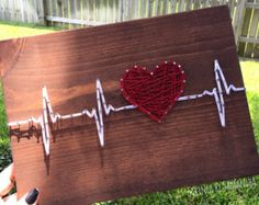 String Art Heartbeat by StringsbySamantha on Etsy Battement de coeur String Art par StringsbySamantha sur Etsy String Art Heartbeat by StringsbySamantha on Etsy Related Post Do you have a hobby you enjoy doing like shopping,. String Art Diy, String Crafts, String Art Heart, Arte Linear, String Art Patterns, Arts And Crafts, Diy Crafts, Creative Crafts, Yarn Crafts