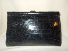 my purses go all around the world this is now in Russia and it is a beautiful black crocodile 20's clutch