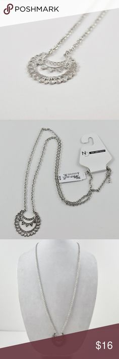 """Silver Filagree Crescent Long Necklace Brand new with tags. All silver. Pendant is a Crescent approximately 2"""" long.necklace is approximately 30"""" in length. Also available in Gold. Bundle offers welcomed. new directions Jewelry Necklaces"""