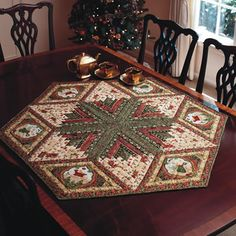 Quilt by Diane Tomlinson.46' point-to-pointDecorate your table with this hexagonal Diamond Log Cabin table topper. Diane Tomlinson used metallic prints to add a little sparkle to her home. Fons and Porter's Love of Quilting, Nov-Dec 2010. Christmas Memories fabric, but Robert Kaufman Holiday Flourish would work well.