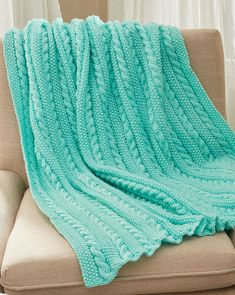 Free Knitting Pattern for Easy Cables & Texture Throw - This easy afghan features a 6 row 13 stitch repeat of seed stitch and cables. Approx. 50 x 54″ / 127 x 137 cm. Worsted weight yarn. Designed by Cathy Payson. Rated easy by Red Heart.