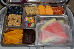 Landon's Lunches from facebook  this is how I pack watermelon (and fruits that can get make the rest of the lunch wet for school):  blueberries, granola bar, dried mango, chocolate brownie, watermelon with press & seal wrap, pepperoni, fire hydrant cheese, wheat thin crackers, jelly beans